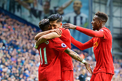WEST BROMWICH, ENGLAND - Easter Sunday, April 16, 2017, 2016: Liverpool's Roberto Firmino celebrates scoring the first goal against West Bromwich Albion with team-mates Emre Can and Divock Origi during the FA Premier League match at the Hawthorns. (Pic by David Rawcliffe/Propaganda)