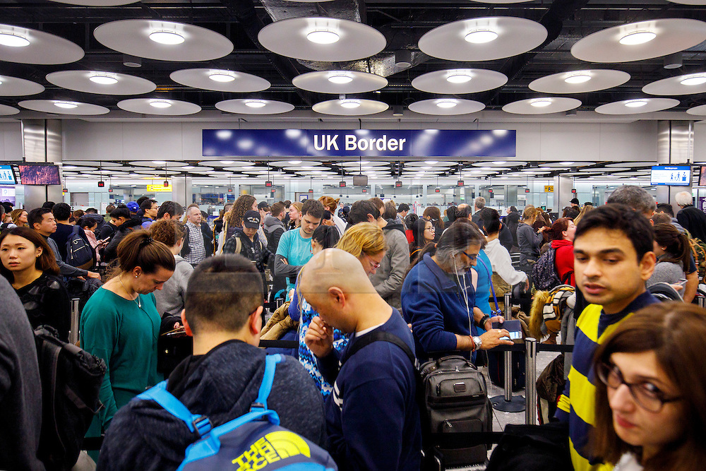 © Licensed to London News Pictures. 23/02/2017. London, UK. FILE PICTURE. People queue for passport checks at Heathrow Airport in London on 30 December 2016. Net migration to Britain fell by 49,000 to 273,000 in the immediate aftermath of the Brexit vote, according to official figures released on 23 February 2017. Photo credit: Tolga Akmen/LNP