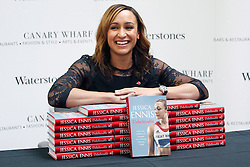 © licensed to London News Pictures. London, UK 09/11/2012. Olympic gold medalist Jessica Ennis posing with her new book 'Jessica Ennis: Unbelievable - From My Childhood Dreams to Winning Olympic Gold' at Jubilee Place Shopping Centre, London before signing copies for her fans. The book hit shelves on 08/11/12. Photo credit: Tolga Akmen/LNP