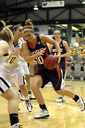 19 March 2010: Jenny Cowen fights her way past the 3 point line. The Flying Dutch of Hope College defeat the Yellowjackets of the University of Rochester in the semi-final round of the Division 3 Women's Basketball Championship by a score of 86-75 at the Shirk Center at Illinois Wesleyan in Bloomington Illinois.