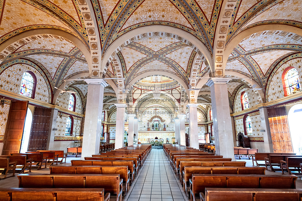 Interior view of the Basilica of Our Lady of Mount Carmel Catholic Church in Catemaco, Veracruz, Mexico. The town is built along a tropical freshwater lake at the center of the Sierra de Los Tuxtlas mountains, is a popular tourist destination and known for free ranging monkeys, the rainforest backdrop and Mexican witches known as Brujos.