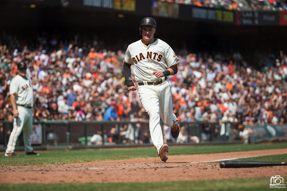 San Francisco Giants first baseman Ryder Jones (63) sprints to home plate to beat a tag for a run scored against the Philadelphia Phillies at AT&T Park in San Francisco, California, on August 20, 2017. (Stan Olszewski/Special to S.F. Examiner)