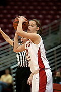 13 November 2005:  Kristi Cirone bites her tongue while concentrating on an inbounds play. With a final score was 93-58, the Illinois State University Redbirds overcome the Bearcats of Northwest Missouri State in an exhibition match up Sunday afternoon at Redbird Arena in Normal Illinois.  The final score was 93-58.