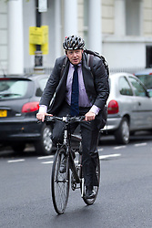 © Licensed to London News Pictures. 19/10/2012. LONDON, UK. Boris Johnson, the Mayor of London, arrives by bike at Pimlico Academy in London today (19/12/12) ahead of delivering a talk on making London a world leader in Education. Photo credit: Matt Cetti-Roberts/LNP