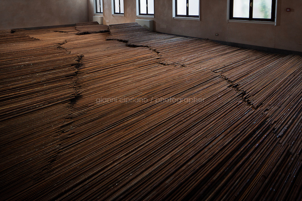 VENICE, ITALY - 28 MAY 2013: Straight, 2008-2012, steel reinforcing bars, 6x12cm, by Artist Ai Weiwei exhibited at the Zuecca Project Space in Venice, Italy, on May 28th 20113. Straight is a project developed using the long steel reinforcing bars recuperated from the schools which collapsed during the Sichuan earthquake in 2008.<br /> <br /> The 55th International Art Exhibition of the Venice Biennale takes place in Venice from June 1st to November 24th, 2013 at the Giardini and at the Arsenale as well as in various venues the city. <br /> <br /> Gianni Cipriano for The New York TImes