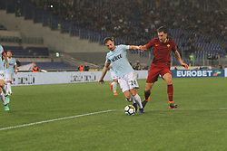 April 15, 2018 - Rome, Lazio, Italy - Stefan Radu defende the ball versus Edin Dzeko.at Stadio Olimpico of Roma. Lazio and Roma tied for 0-0 the ''derby della Capitale'' of Italian Serie A. (Credit Image: © Paolo Pizzi/Pacific Press via ZUMA Wire)