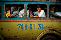 1993, Hue, Vietnam --- Passengers on a Bus in Vietnam --- Image by © Owen Franken/CORBIS