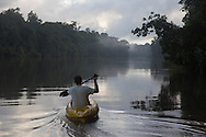 French Guyana. Amazonas forest and river. Host Oliver (Olly)  on a kayak on the Approuague river in amazonia,      / Host Oliver (Olly) sur un kayak sur le fleuve Approuague en amazonie , pour un film , extreme expeditions,  guyane.
