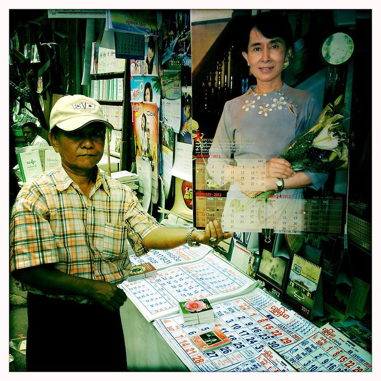 Street vendor proudly displays an Aung San Suu Kyi calender, Yangon (Rangoon) Myanmar (Burma) January 2012