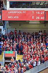 LIVERPOOL, ENGLAND - Sunday, May 12, 2019: Liverpool supporters celebrate as news spread of a Brighton goal in the game featuring Brighton & Hove Albion and Manchester City, leaving the Reds top of the table, during the final FA Premier League match of the season between Liverpool FC and Wolverhampton Wanderers FC at Anfield. (Pic by David Rawcliffe/Propaganda)