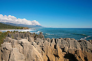 pancake rocks at punakaiki with view along the nz coast and paparoa national park, west coast, new zealand
