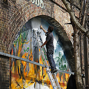 London,England,UK : 10th April 2016 : 13 world-renowned street artists take on 120 metre stretch of railway arches with live paintings of 'Endangered 13' animals at Ackroyd Drive Sponsor by Tower Hamlets council in London. Photo by See Li
