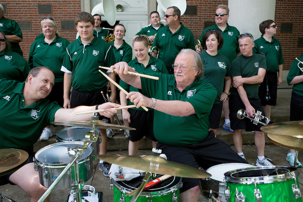 "Members of the Ohio Alumni Varsity Band prepare to perform for Ohio Univeristy alumni and their families during a barbecue on the College Green on May 31, 2014. The event was part of the ""On The Green"" weekend, hosted by the Ohio University Alumni Association. Photo by Lauren Pond"