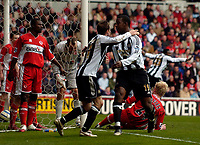 Photo: Jed Wee.<br /> Middlesbrough v Newcastle United. The Barclays Premiership. 09/04/2006.<br /> <br /> Newcastle's Titus Bramble (R) and Lee Bowyer celebrate after pouncing on confusion in the Middlesbrough goalmouth to score the opening goal.