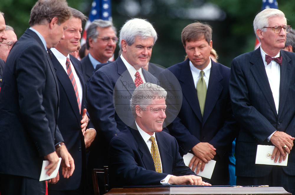 WASHINGTON, DC, USA - 1997/08/05: U.S. President Bill Clinton prepares to sign the balanced budget bill during a ceremony on the South Lawn of the White House August 5, 1997 in Washington, DC. Standing around Clinton from left to right are: Rep. Thomas Davis III, Vice President Al Gore, Speaker Newt Gingrich, Rep. John Kasich and Rep. Thomas Bliley Jr.  (Photo by Richard Ellis)