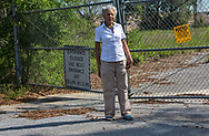 Esther Powell in front of a landfilll next to her home in Pensacola Florida.