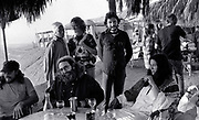The Grateful Dead – Egypt 1978 . Ken kesey, Bob Weir and Richard Loren and guests at the Sahara City after show dinner.