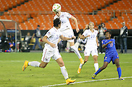 20 October 2014: Megan Rapinoe (USA) (15) heads the ball over Abby Wambach (USA) (20), Tobin Heath (USA), and Yvrose Gervil (HAI) (right). The United States Women's National Team played the Haiti Women's National Team at RFK Memorial Stadium in Washington, DC in a 2014 CONCACAF Women's Championship Group A game, which serves as a qualifying tournament for the 2015 FIFA Women's World Cup in Canada. The U.S. won the game 6-0.