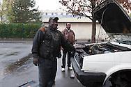 = La Courneuve , cite of 4000.  Oudo is repairing cars in the cite, it s the underground economy  Paris  France    /// La Courneuve, cite des 4000 , Oudo, le garagiste independant est camerounais et repare les voitures sur place,  Paris  France +