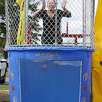 Lauren Wood | Buy at photos.djournal.com<br /> Kayla Buckner of Courtyard by Marriott falls into the water of the dunk tank Thursday morning during the Dunk A Boss fundraiser at the Courtyard by Marriott hotel. Proceeds from the fundraiser will benefit Habitat for Humanity.