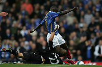 Photo: Lee Earle.<br /> Portsmouth v Bolton Wanderers. The FA Barclays Premiership. 18/08/2007.Portsmouth's John Utaka (R) beats Bolton keeper Jussi Jaaskelainen to score their second goal.