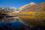 Fall colors are reflected in the still water of North Lake, Inyo National Forest