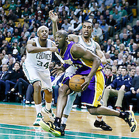 07 February 2013: Los Angeles Lakers shooting guard Kobe Bryant (24) drives past Boston Celtics shooting guard Courtney Lee (11) and Boston Celtics small forward Paul Pierce (34) during the Boston Celtics 116-95 victory over the Los Angeles Lakers at the TD Garden, Boston, Massachusetts, USA.