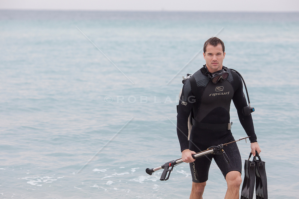 scuba diver at the beach in Fort Lauderdale, Florida looking like he came out of a James Bond movie