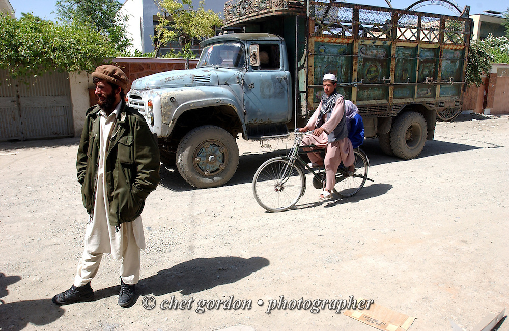 Truck delivery driver awaits payment in Kabul, Afghanistan on Thursday, May 23, 2002.