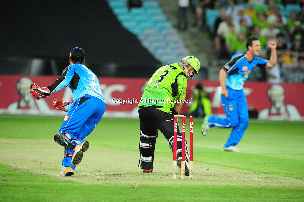 23.12.2011 Sydney, Australia.Thunder captain Daniel Smith is bowled by Adelaide Strikers all rounder Aaron O'Brien during the KFC T20 Big Bash Cricket League game between Sydney Thunder and Adelaide Strikers at ANZ Stadium Sydney.