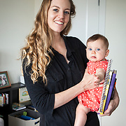 "Laurie Pickard, with her 6 month-old twin, Holly in her Alexandria apartment, on Thursday, August 31, 2017. Pickard earned an M.B.A utilizing free online courses from a variety of prestigious universities. Furthermore, she started a website called nopaymba.com that is a resource for anyone seeking to do the same. Her book, called ""Don't Pay for Your M.B.A"" will be published in October. CREDIT: John Boal for The Wall Street Journal"