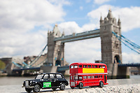 Public transport figurines with London Bridge in the background