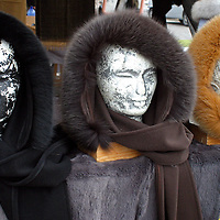 Europe, Scandinavia, Finland, Helsinki. Fur scarves displayed on wig stands give an eerie reminder of winter in Finland.