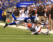 August 24, 2013:  Indianapolis Colts wide receiver Reggie Wayne (87) makes a catch and is tackled by Cleveland Browns cornerback Buster Skrine (22) during a preseason NFL game between the Cleveland Browns and the Indianapolis Colts at Lucas Oil Stadium in Indianapolis, IN.
