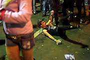 A man using a cowboy hat holds his beer can and caipirinha as he falls to the ground at the amusement park set aside the  Cowboy Festival i in the city of Barretos, Brazil, Thursday, Aug. 23, 2012. The festival which gathers ten of thousands each year in August  is long awaited by cowboys, cowgirls and big sponsors related to the industry of meat, beer and leather. The festival has its origins in the transfer of cattle from pasturing in the nearby states of Minas Gerais, Goiás, Mato Grosso do Sul, and Mato Grosso to slaughterhouses in Barretos, still home to two of Brazil biggest protein transformation industries, JBS Friboi and Minerva.  Brazil is on a quick path to become a global power. Rising economy, big infrastructure projects, an emerging and eager consuming middle class and the booming national industry are the evidences and consequences of the wealth in the southern nation. But the often hidden source of all this wealth falls far from the luring Rio beaches or the Kolkata-New York mix that Sao Paulo is. Behind texan hats and a similar attitude the countrymen display their power through a myriad of projects, festivals and behavior visually analyzed here.