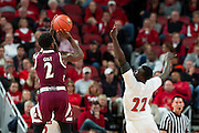 Louisville forward Deng Adel, right, contests a shot by Eastern Kentucky guard Asante Gist in the first half. The University of Louisville hosted Eastern Kentucky University, Saturday, Dec. 17, 2016 at The KFC Yum Center in Louisville.