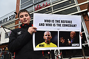 """A young fan with a poster """"Who is the Referee and Who is the Comedian"""" which is comparing Mike Dean to Jasper Carrott before the Premier League match between Bournemouth and Tottenham Hotspur at the Vitality Stadium, Bournemouth, England on 11 March 2018. Picture by Graham Hunt."""
