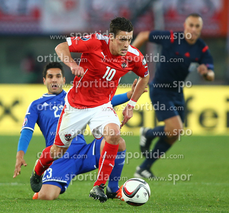 12.10.2015, Ernst Happel Stadion, Wien, AUT, UEFA Euro 2016 Qualifikation, Oesterreich vs Liechtenstein, Gruppe G, im Bild Michele Polverino (LIE) und Zlatko Junizovic (AUT) // during the UEFA EURO 2016 qualifier group G between Austria and Liechtenstein at the Ernst Happel Stadion, Vienna, Austria on 2015/10/12. EXPA Pictures © 2015, PhotoCredit: EXPA/ Thomas Haumer