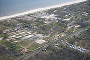 Coastal damage similar to this extends over 100 miles along the coast from Biloxi, Mississippi, to New Orleans, Louisiana.  Note FEMA trailers in the bottom corner.