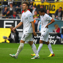 18.08.2013, Signal Iduna Park, Dortmund, GER, 1. FBL, Borussia Dortmund vs Eintracht Braunschweig, 2. Runde, im, Bild Ermin Bicakcic #3 (Eintracht Braunschweig) und Omar Elabdellaoui #14 (Eintracht Braunschweig) schleichen enttaeuscht vom Platz,  // during the German Bundesliga 2nd round match between Borussia Dortmund and Eintracht Braunschweig at the , Signal Iduna Park, Dortmund, Germany on 2013/08/18. EXPA Pictures &copy; 2013, PhotoCredit: EXPA/ Eibner/ Joerg Schueler<br /> <br /> ***** ATTENTION - OUT OF GER *****