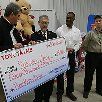 Mike Botkin with Toyota presents a check for $15,000 to Maj. Jeff Daniel with the Salvation Army to help with the red kettle drive.