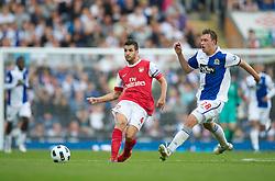 BLACKBURN, ENGLAND - Saturday, August 28, 2010: Arsenal's Cesc Fabregas in action against Blackburn Rovers' Phil Jones during the Premiership match at Ewood Park. (Pic by: David Rawcliffe/Propaganda)