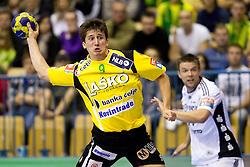 David Razgor (#9) of Celje during the handball match between RK Celje Pivovarna Lasko (SLO) and TWH Kiel (GER) in 4th Round of Velux EHF Men's Champions League, on October 17, 2010 in Arena Zlatorog, Celje, Slovenia.  (Photo By Vid Ponikvar / Sportida.com)