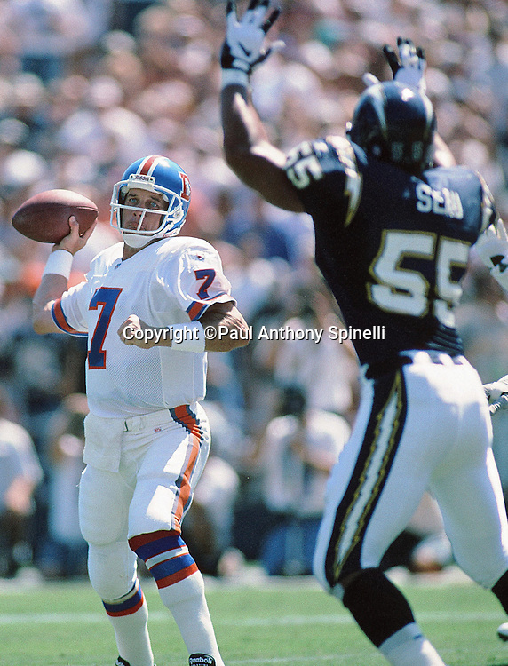 Denver Broncos quarterback John Elway (7) is pressured by San Diego Chargers linebacker Junior Seau (55) while throwing a pass during the NFL football game against the San Diego Chargers on Sept. 24, 1995 in San Diego. The Chargers won the game 17-6. (©Paul Anthony Spinelli)
