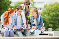 Group of friends studying together at university campus