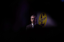 "© London News Pictures. ""Looking for Nigel"". A body of work by photographer Mary Turner, studying UKIP leader Nigel Farage and his followers throughout the 2015 election campaign. PICTURE SHOWS - Nigel takes to the stage during the UKIP Spring Conference in the Winter Gardens theatre in Margate, Kent on February 27th 2015 to give one of his most rousing speeches to the assemble UKIP supporters who had arrived from all around the country to attend the event. . Photo credit: Mary Turner/LNP **PLEASE CALL TO ARRANGE FEE** **More images available on request**"