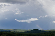 Blooming Grove, New York - A rainbow appears behind Round Hill and Schunnemunk Mountain after a summer storm on July 28, 2014.