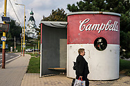 MEDZILABORCE, SLOVAKIA - SEPTEMBER 5, 2018: A bus stop is painted like a Campbell's Soup can outside the Andy Warhol Museum of Modern Art on Wednesday, September 5, 2018 in Medzilaborce, Slovakia. Andy Warhol's parents were both born in the nearby village of Mikova, and married there before separately moving to America and giving birth to their famous son. CREDIT: Brendan Hoffman for The New York Times