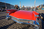 During summer from June to Septemper, every first Friday of the month is Vintage Car Cruising Night. Hundreds of classic American cars cruise around downtown Helsinki and meet at special places to have a good time, here at Kauppatori (Market Square). 1959 Cadillac DeVille convertible.
