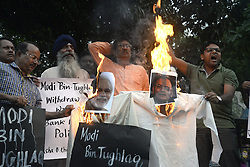 November 9, 2016 - Kolkata, West Bengal, India - Indian Prime Minister Narendra Modi and Finance Minister Arun Jetly effigy burns during a protest against the Indian government decision to withdraw of Rs.500 and Rs. 1000 bank notes across India today in Kolkata. (Credit Image: © Saikat Paul/Pacific Press via ZUMA Wire)